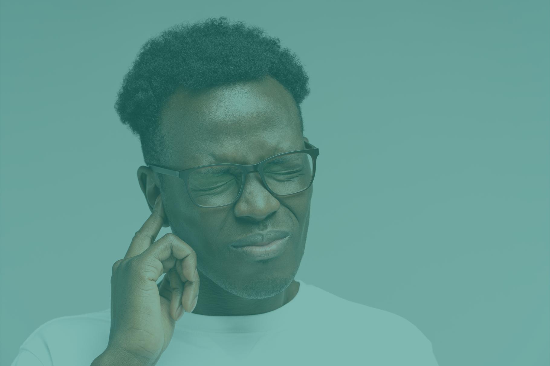 black-man-frowning-suffering-from-tinnitus-throbbing-green